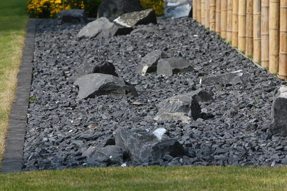 use rocks in your landscape to create a simple rock garden
