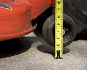Measuring the height of a mower deck