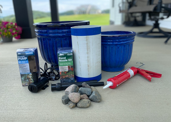 Materials required for a DIY water fountain grouped together for a picture